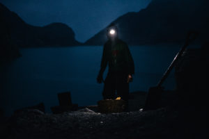 Ijen Volcano Sulfur Miner at Crater Lake in the Dark with head lamp