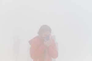 Tourist with gas mask caught in sulfur cloud