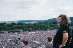 Photographer Eugen Kukla overlooks Milion Chvilek protests in letná Prague standing on a rooftop